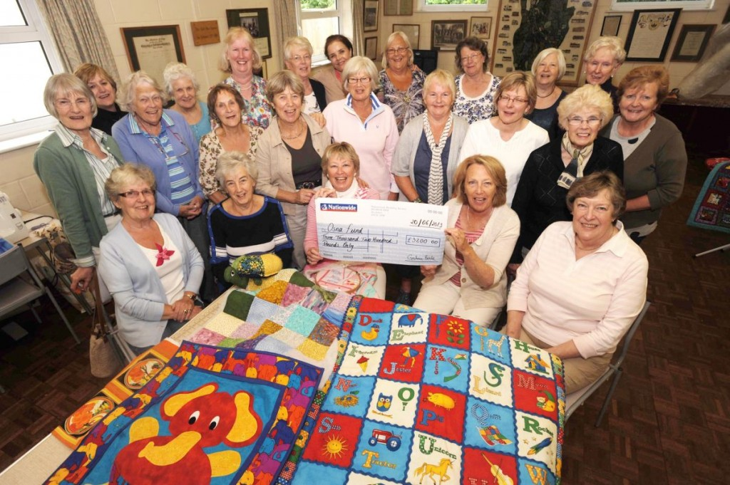 Corfe Quilters, with a cheque to Musgrove Park Hospital.